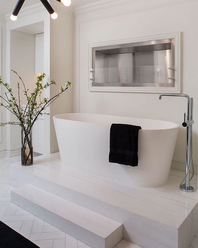 Master bathroom featuring an elevated stand-alone tub and fireplace creating the ultimate luxury for relaxation.  #interiordesign #interiordecor #luxurydesign #residencialdesign #ultimateluxury #penthouse #masterbathroom #fireplace #abovethepenthouses #luxury #interiors