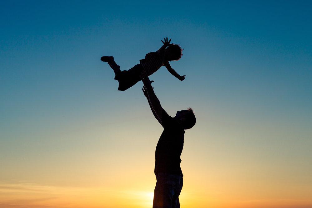 MLBS dad throwing kid in sky stock photo.jpg
