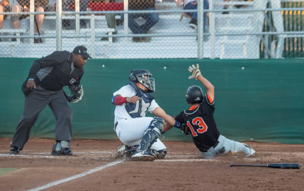 Wilkyns Jimenez (16) tags out Masahiro Miyadera (13) of the Diamonds at the plate in the early innings of Thursday's game at Joe DiMaggio Field.  Photo:   M C Hunt