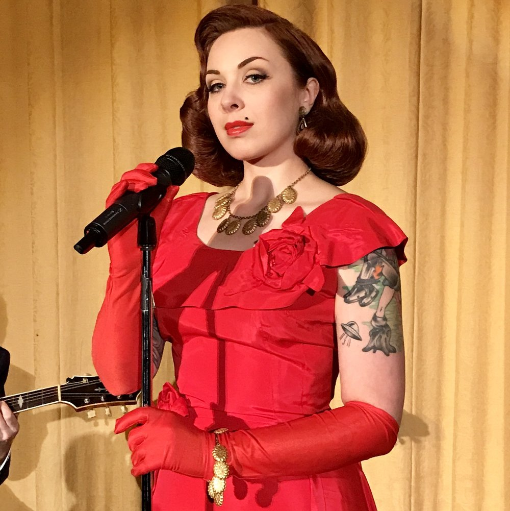Annabelle Zakaluk - [SINGER/ACTOR] Annabelle is a New Yorker calling San Francisco her home for 9 years. She spends her time swing dancing, collecting vintage clothing, exploring history, and singing with The Century Sisters: a 3-part, tight harmony sister act singing songs from the '20s thru '40s. Though she has been singing on stages for 20 years, this may be considered her acting debut. www.centurysisters.com/media [S2E9]