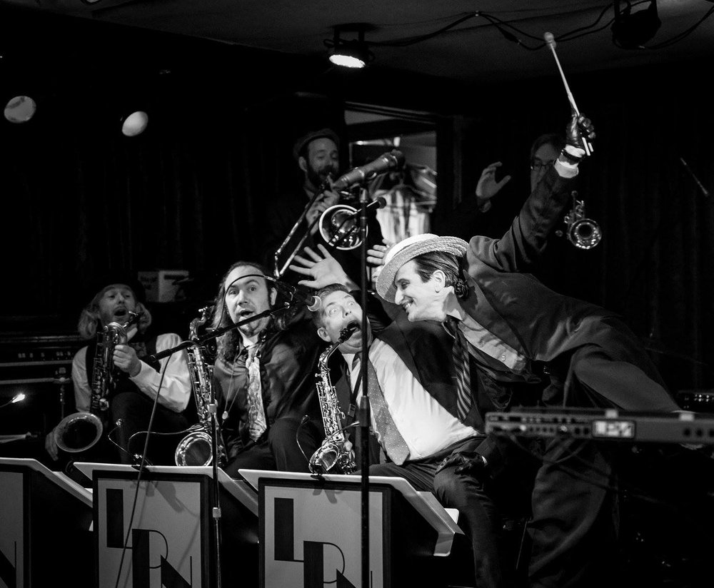 Lee Presson & the Nails - [MUSICIAN] With a five-piece horn section, the band differentiated itself from other bands of the late '90s swing revival by stage antics and the sinister appearance of band leader Lee Presson. The San Francisco Chronicle described the band in 1996 by coining the term