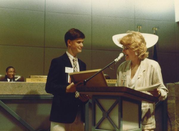 "In middle school in 1987, I participated in a program where students ""ran the city for a day."" In this photo, I received an award from Mayor Harley."