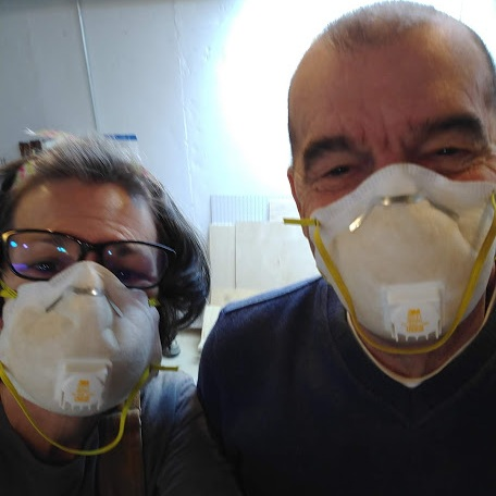 Dad's so silly! And he's safety conscious. The dynamic duo of sanding madness.