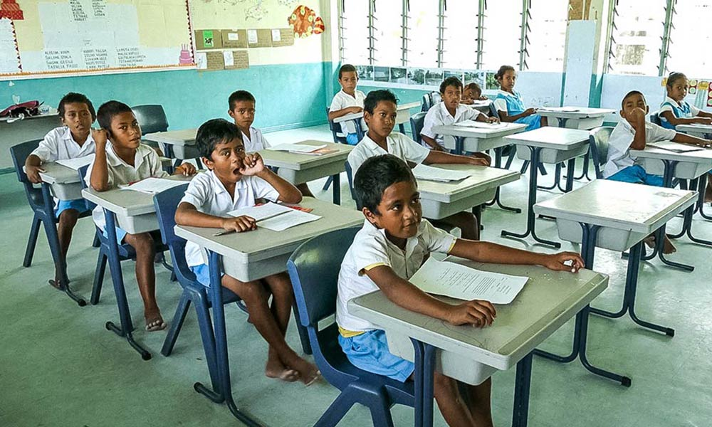 School kids in Nui island, Tuvalu. After cyclone Pam the primary school in Nui island was flooded due to a wave surge. Photo: Silke von Brockhausen/UNDP