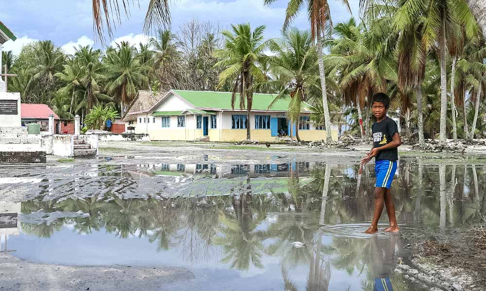 The main square of Nui island remained under water over a month after Cyclone Pam. Photo: Silke von Brockhausen/UNDP