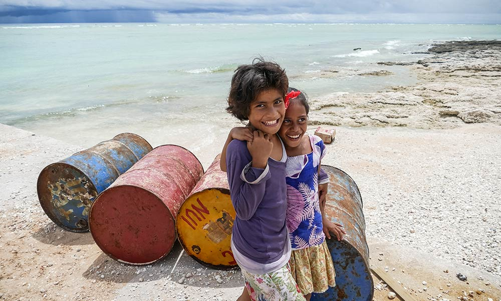 Kids at the port of Nui island, Tuvalu, post Cyclone Pam. Photo: Silke von Brockhausen/UNDP