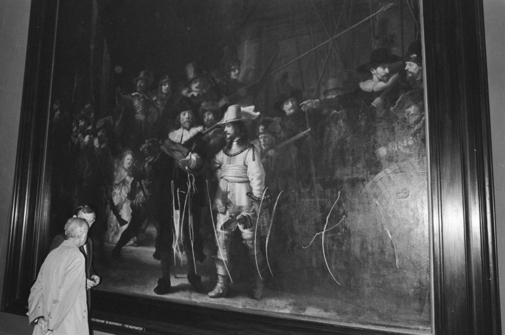 """Rembrandt, """"The Night Watch"""" 1642 / bread knife  In September 1975, this painting was damaged while on view at Amsterdam's Rijksmuseum. Wilhelmus de Rijk, a 38-year-old former teacher from the village of Bloemendaal, used a bread knife to carve a series of jagged cuts into the canvas.Even after a guard grabbed his arm, de Rijk continued moving across the painting, slashing with the knife and tearing away a portion of canvas.  Rijk, who had obtained the knife from at a downtown restaurant where he'd eaten lunch before going to the museum, told police he'd been """"sent by the Lord.""""""""I was ordered to do it,"""" he said. """"I had to do it.""""Authorities said he had a history of mental illness and was initially held on a charge of willful destruction. In the end, he was not taken to trial, but instead sent to an asylum, where he eventually committed suicide.   This wasn't the first or last time the painting was attacked: in separate incidents, it was sprayed with acid, slashed by knife, and had portions deliberately removed by Amsterdam officials.Learn more: http://art-damaged.tumblr.com/post/21583538174/rembrandt-the-night-watch-butter-knife-acid"""