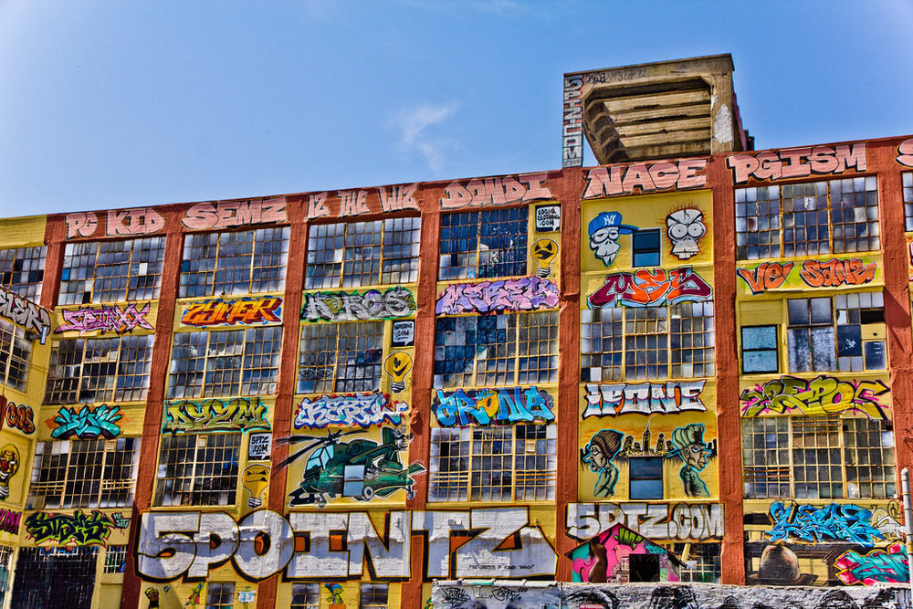 "A judge's order will send to trial a suit by a group of graffiti artists against a real estate owner who destroyed their murals at the 5Pointz site in Queens, New York.   After a four-year battle, Senior US District Judge Frederic Block's order, filed March 31, 2017, grants the 5Pointz graffiti artists' right to sue under the Visual Artists Rights Act of 1990.   Curated by a graffiti artist named Meres One (Jonathan Cohen) since 2002, the colorful murals were a reminder of a grittier past in a gentrified neighborhood bustling with new high-rise construction. They attracted tourists by the busload and featured works by artists from as far away as Australia and Japan. Graffiti artists had been plastering the walls with their works since 1993.   When Wolkoff resolved to destroy the buildings to make way for a new residential development, artists brought suit to stop him in order to preserve their artworks, asserting a claim under VARA as well as ""intentional infliction of emotional distress,"" conversion, and property damage. Their case was thrown out, and, without warning one night during November 2013, the owners whitewashed the murals, erasing, as the artists' spokeswoman told the  New York Times , the work of at least 1,500 artists. The abrupt erasure allowed the artists no time to document or preserve their work.   ""The court's order denying dismissal of our client's claims is a groundbreaking decision for aerosol artists around the country,"" said Eric Down of Eisenberg & Down, the firm that is representing the artists. ""The message is that if you destroy art protected by federal law, you will be held responsible for your actions…We are confident that at trial both the artists and their work will be determined to be of recognized stature.""   As Amy Adler, law professor at New York University, observed in a phone interview, ""Key in this matter is whether the works are of recognized stature, but the statute doesn't define recognized stature and there's not a lot of precedent since it's not a heavily litigated area like fair use. And it's not necessarily determined by the criteria that the art world would apply."""