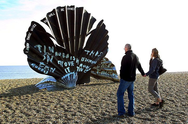 """Maggi Hamblings """"Scallops"""" / paint   (This public sculpture - created on commission as a tribute to English composer Benjamin Britten - has been vandalized 13 times since being installed on a beach in Aldeburgh, England in 2003. The subject of much debate amongst locals (numerous petitions have been made to have the sculpture removed), the work was most recently defaced in 2011, when someone painted it with phrases like """"ITS JUST AN OLD TIN CAN,"""" """"JUNK,"""" and """"MOVE IT."""")"""