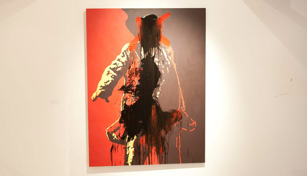 "Brett Murray ""The Spear"" / paint   (On May 22, 2012, this controversial painting of South African president Jacob Zuma (which depicts the politician, genitals exposed, in a dramatic pose reminiscent of Soviet-era poster work) was defaced while on view at Johannesburg's Goodman Gallery.   The artwork was damaged by two men - one of whom painted a red X across Zuma's face and genitals as the other threw black paint onto the canvas.   One of the men, arrested at the scene, said simply, ""The painting was offensive."")"