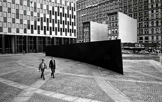 """Richard Serra """"Titled Arc"""" / US government   (In 1981, the US Arts-in-Architecture program (part of the US General Services Administration) commissioned artist Richard Serra to create a work of public art for the Federal Plaza in NYC.   The work proved controversial from the outset: some balked at its cost ($175,000 for a solid block of steel); others objected to the graffiti and rats it seemed to attract; others simply found it an eyesore. Most significantly, a number of people working in surrounding buildings complained that the work was an inconvenience, as they were forced to walk around the massive sculpture as they crossed the plaza. (Which, according to Serra, was precisely the point: """"The viewer becomes aware of himself and of his movement through the plaza. As he moves, the sculpture changes. Contraction and expansion of the sculpture result from the viewer's movement. Step by step the perception not only of the sculpture but of the entire environment changes."""")   As a result of this controversy, Judge Edward Re began a campaign to have the the sculpture removed. In 1985, there was a public hearing to determine whether  Tilted Arc  should be relocated. Serra, for his part, argued that work was site specific, that to remove it would be to destroy it, and if it was relocated, he would remove his name from the piece. At the end of the hearing, a jury ruled 4-1 to remove the piece. Serra appealed, and the ruling was debated over the course of the next five years or so.   In the end, the jury's ruling was upheld. Exercising proprietary rights, authorities of the General Services Administration ordered the destruction of the public sculpture that their own agency had commissioned ten years earlier. Government workers dismantled the work on March 15, 1989.)"""