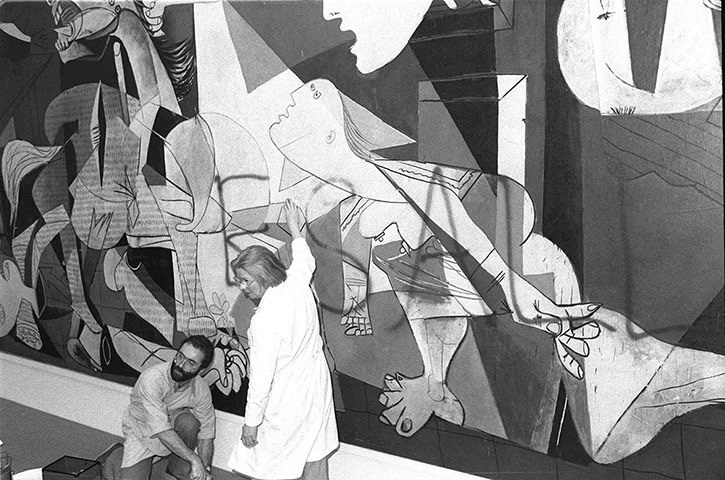 """Pablo Picasso """"Guernica"""" / spray paint   (Vandalized by then-artist / current-art-dealer Tony Shafrazi, who in 1974 smuggled a can of red spray paint into MOMA and wrote """"KILL LIES ALL"""" across the painting. Shafrazi was apparently protesting Nixon's pardon of William Calley, a participant in the My Lai massacre.As police took him into custody, Shafrazi said, """"Call the curator. I am an artist."""" The spraypaint was non-archival and easily removed.)"""