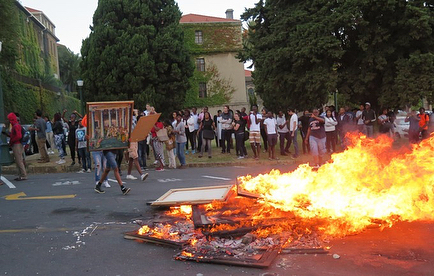 "In 2016, students of the University of Cape Town stole and set fire to artworks from the school's collection during the ""Shackville"" protests that arose as part of the Rhodes Must Fall (RMF) movement.  RMF began in 2015 as a campaign to remove an on-campus statue of British Imperialist Cecil Rhodes. Protests resumed the following year in response to perceived failings in the university's housing policies - specifically, a lack of housing for black students. In protest, RMF members erected a small shack on campus grounds, symbolizing the way black students were being displaced. That same day, the university tore it down.  In retaliation, the protesters undertook a series of violent acts: setting numerous cars ablaze, petrol-bombing the vice-chancellor's office and, as shown above, starting a bonfire with artworks taken from the UCT's collection. #artdamaged"