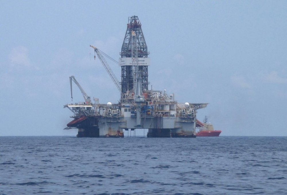 Rig drilling a relief well