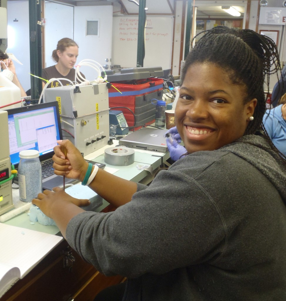 Chassidy running the gas chromatograph
