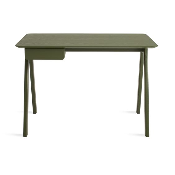 Blu Dot Stash Desk   Radius edges and wood couple in this elemental writing desk. Pencil drawer keeps it tidy and can be assembled to either the left or right side.