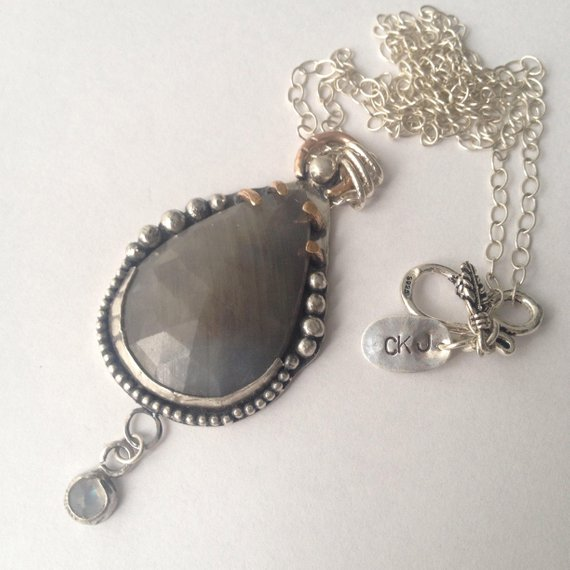 CKJ-twilight-jewels-sapphire-wolf-pendant.jpg