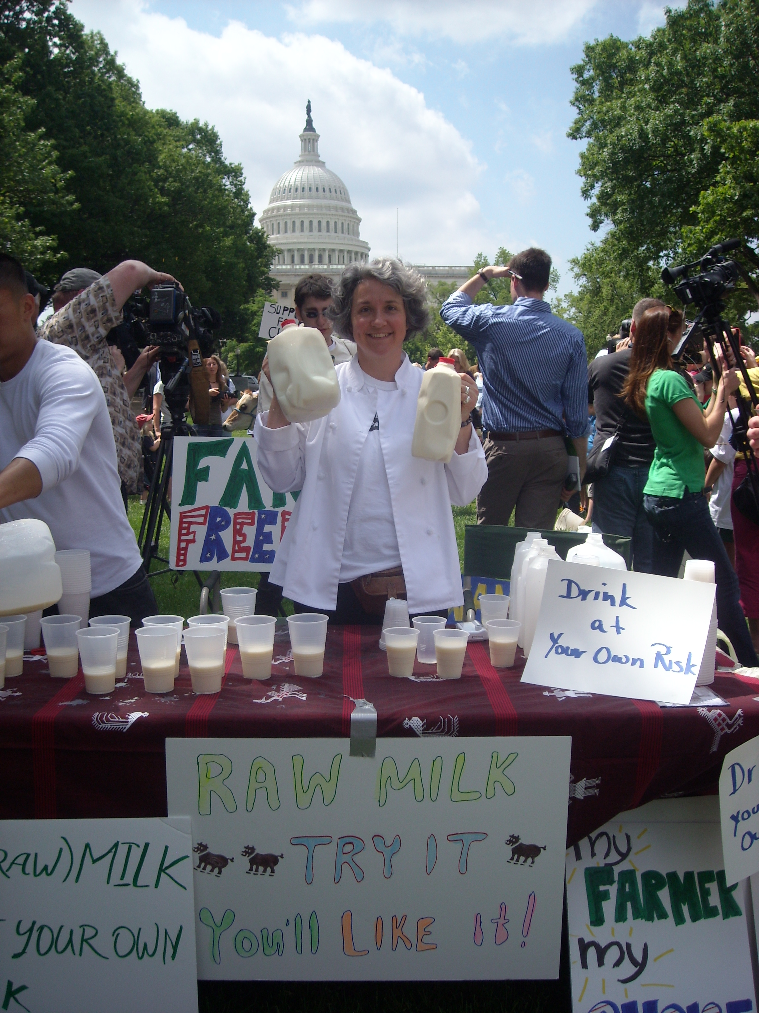 Monica pouring raw milk on the Hill