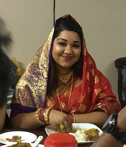 Candid shot of me eating rice and curry as a newlywed bride