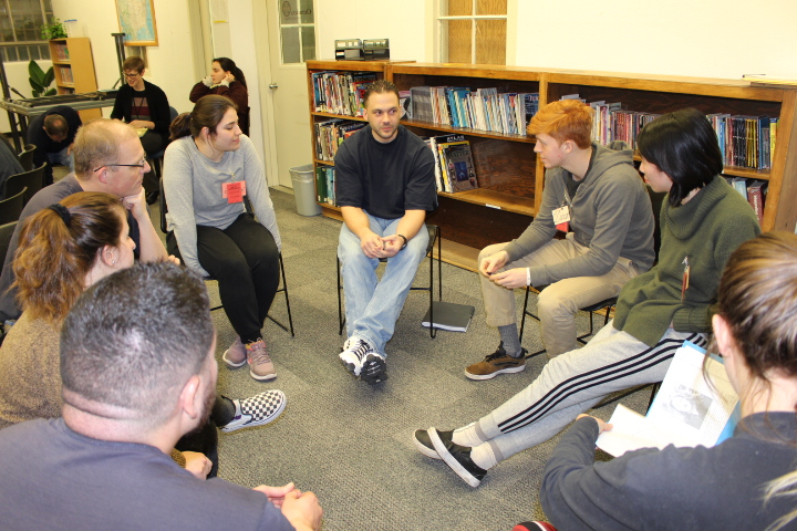 Students discuss prisoner narratives and conflict resolution