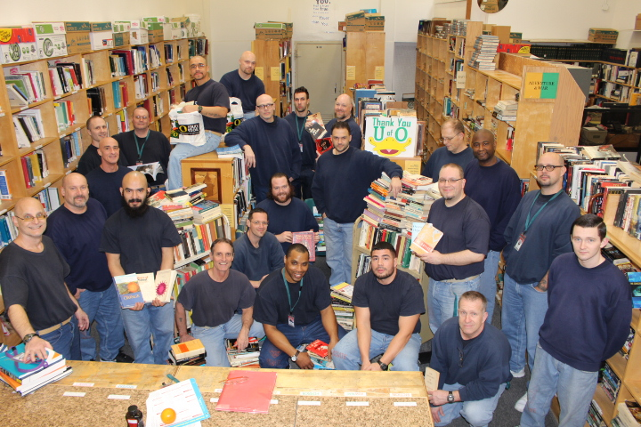Inside folks at the library at OSCI organizing the donated books.