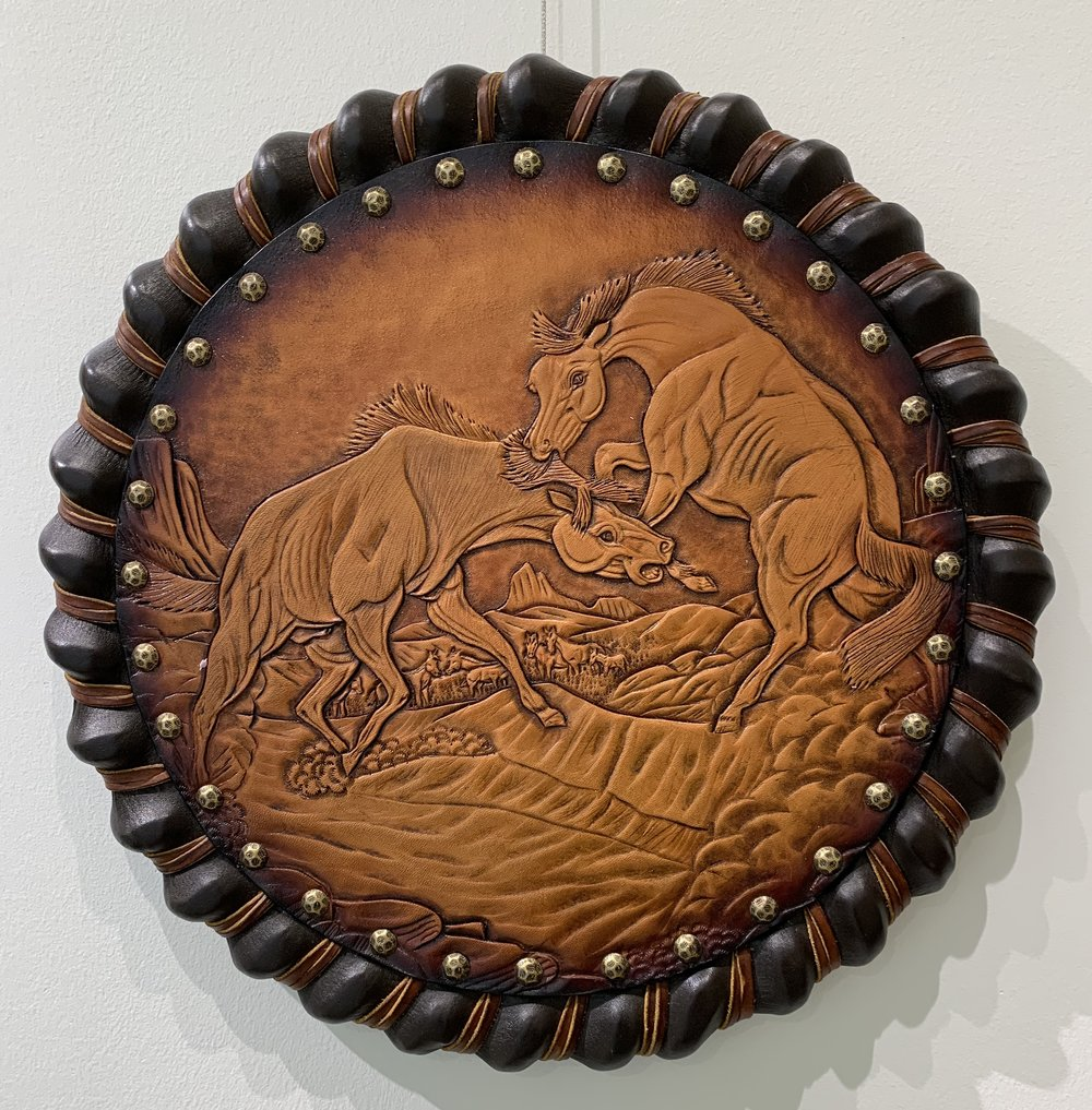 "Ron, Wild Horses - Carved leather""Ron has done leather art and crafts for the past three decades."""