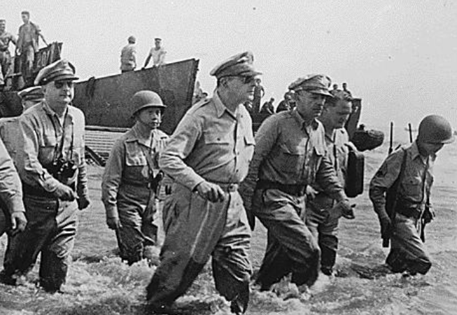 Gen. Douglas MacArthur's (foreground) dramatic landing in Leyte, Philippines, on Oct. 20, 1944, during World War II. (Photo courtesy of the National Archives.)