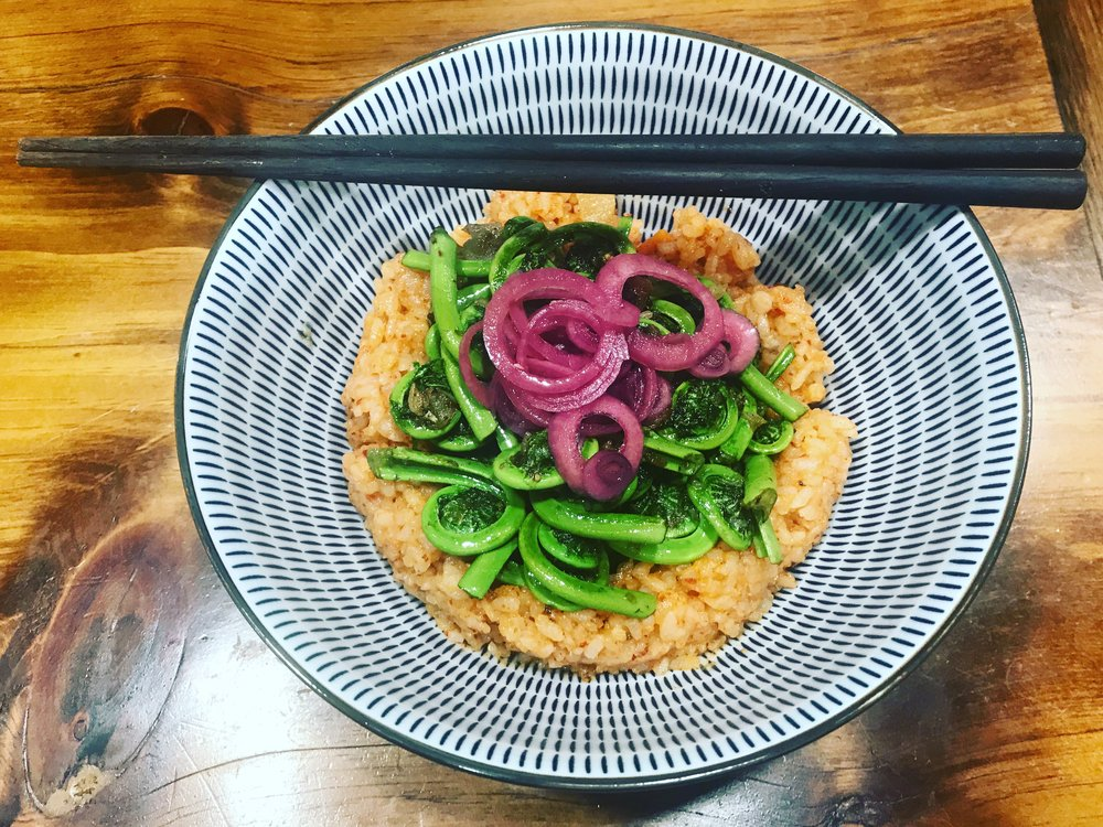 Local Fiddle Heads in butter, garlic, shallots, pickled onions and kimchi rice