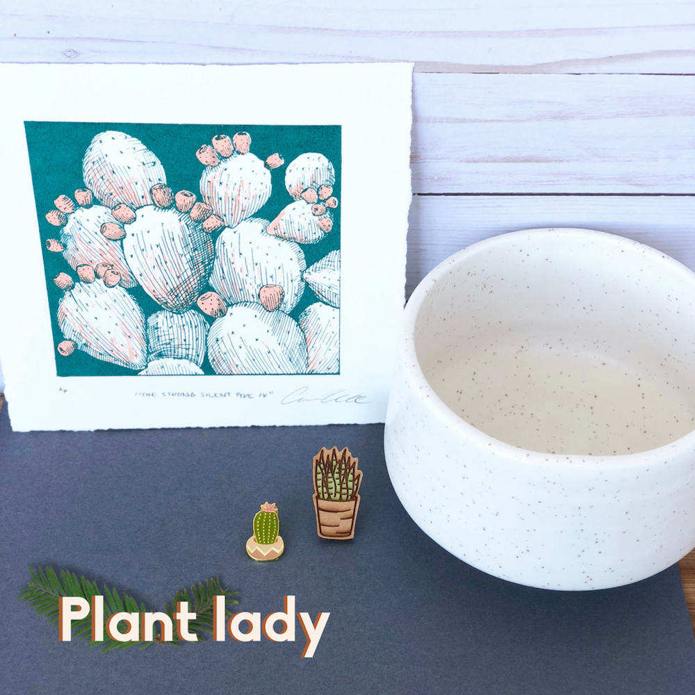 Plant Lady, cactus print, white planter, aloe vera pin, and cactus pin.
