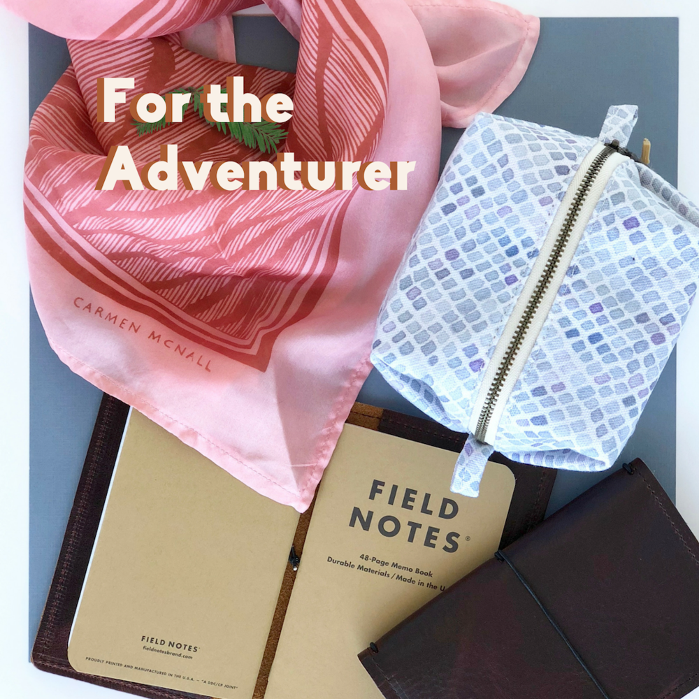Adventurer: Pink silk scarf, blue mesh pouch, brown leather notebook.