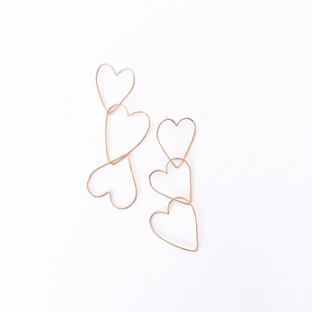 Three hearts outline dangle statement earrings.