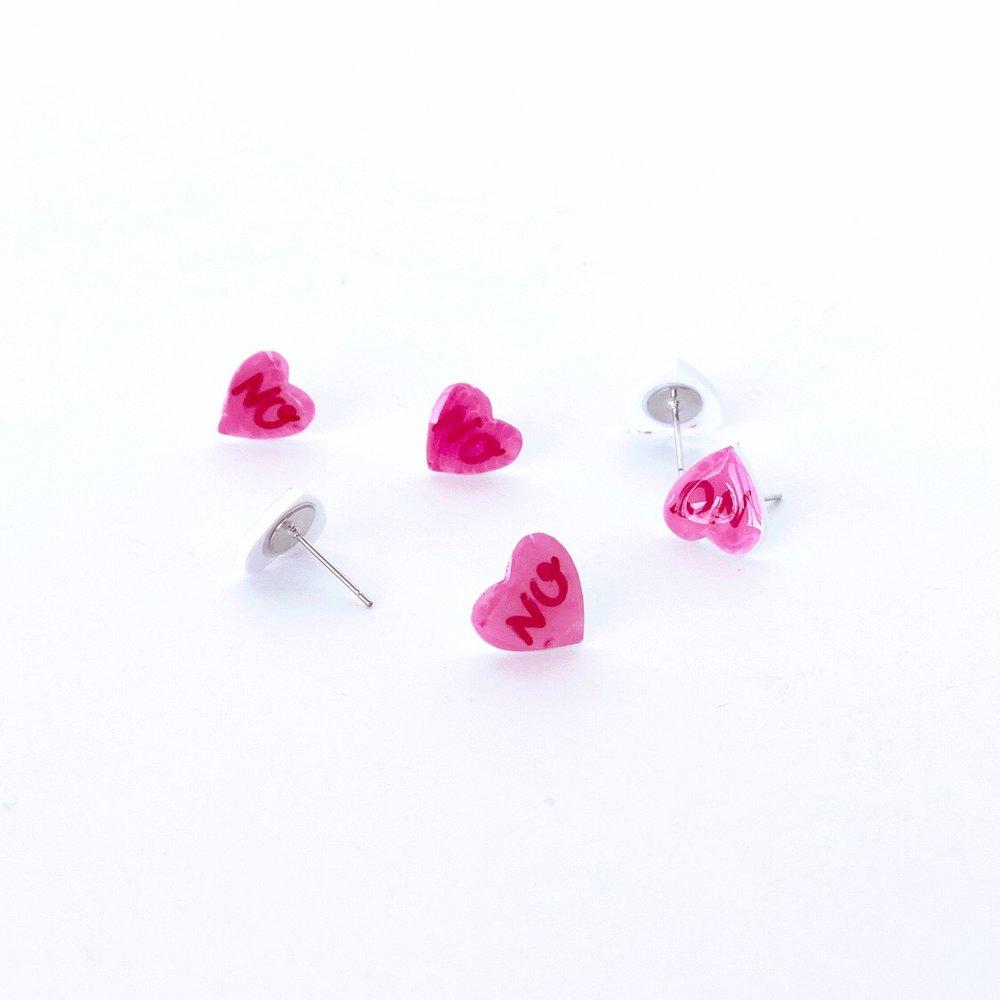 Conversation heart stud earrings.