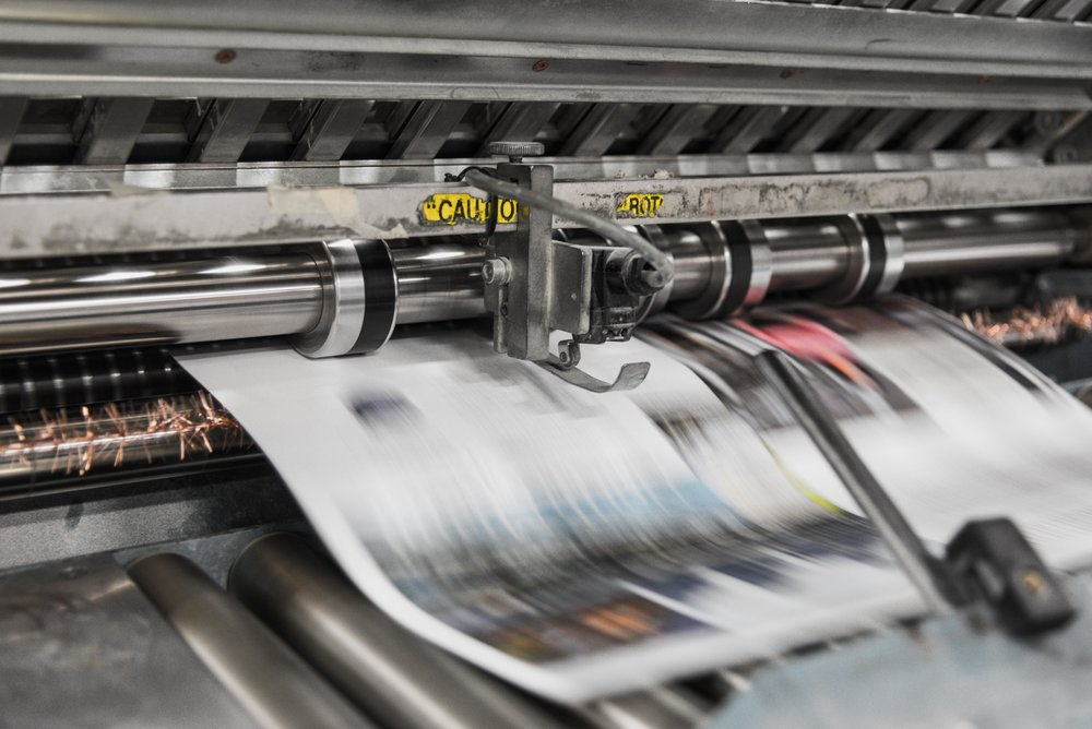 newspaper coming off the press