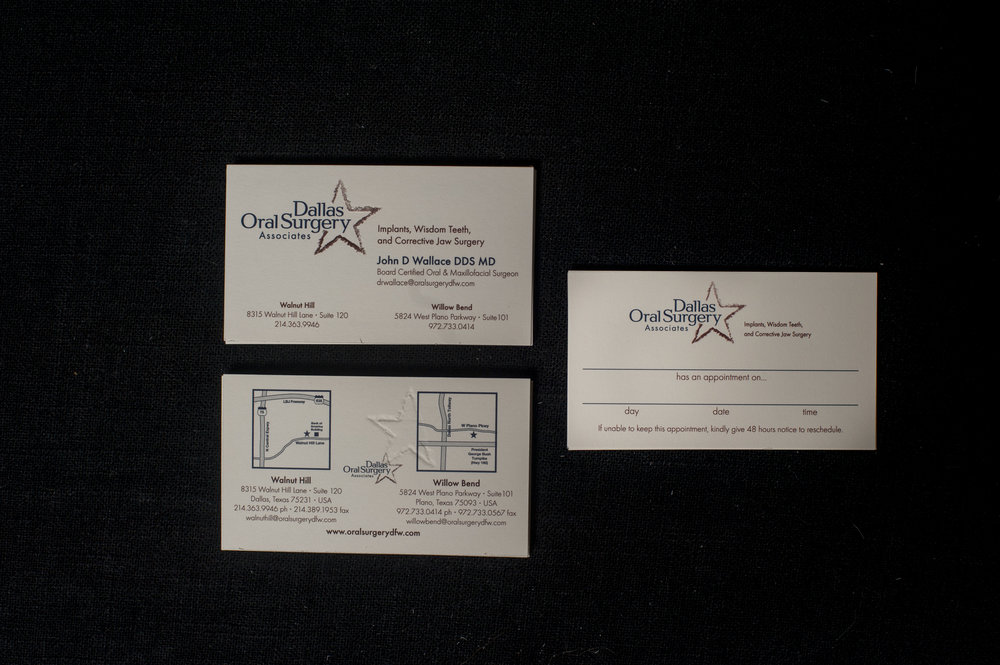 Business cards and appointment cards for Dallas Oral Surgery Associates, complete with location maps on the back.