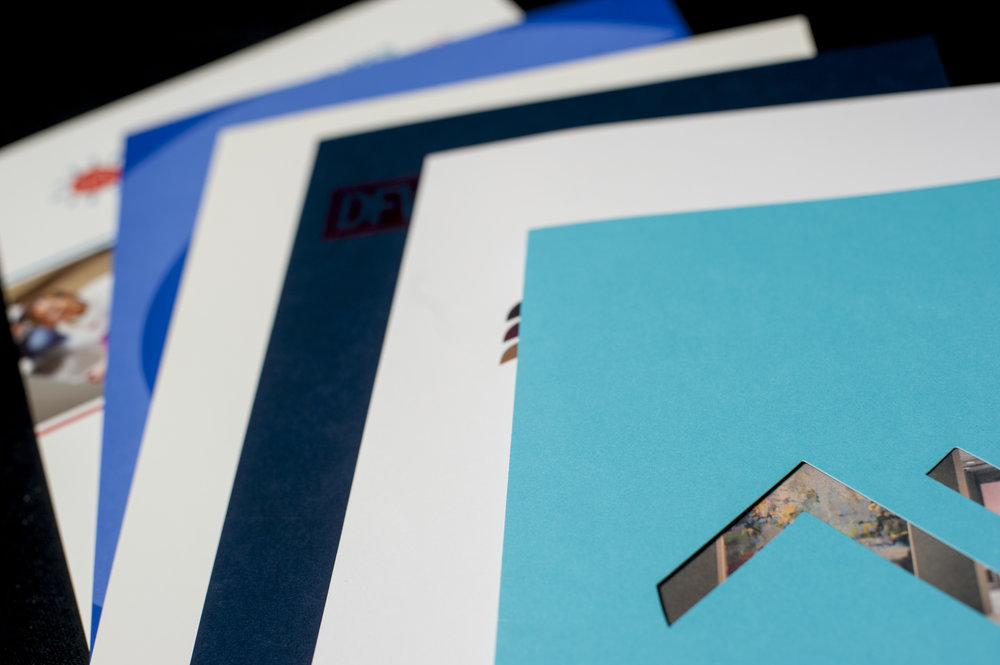 A variety of custom folders printed by M&S Graphic Arts.