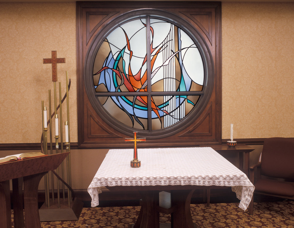 The room also services as a Chapel, so this window, with a more spiritual theme, serves as a backdrop to the Altar.