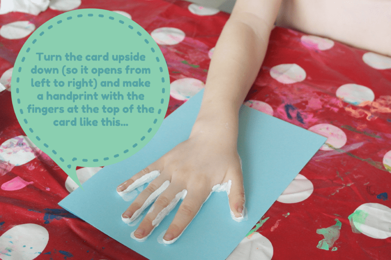 Turn-the-card-upside-down-so-it-opens-from-left-to-right-and-make-a-handprint-with-the-fingers-at-the-top-of-the-card-like-this....png