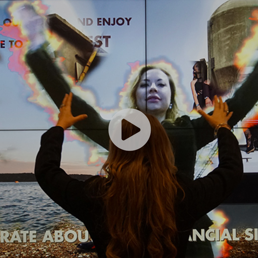 Fire and Smoke Reveal - Fire and Smoke Reveal is an application with a fire and smoke effect, surrounding peoples' body movements. As they walk by the screen, a hidden image, message or a video appears, which draws their attention to your product.