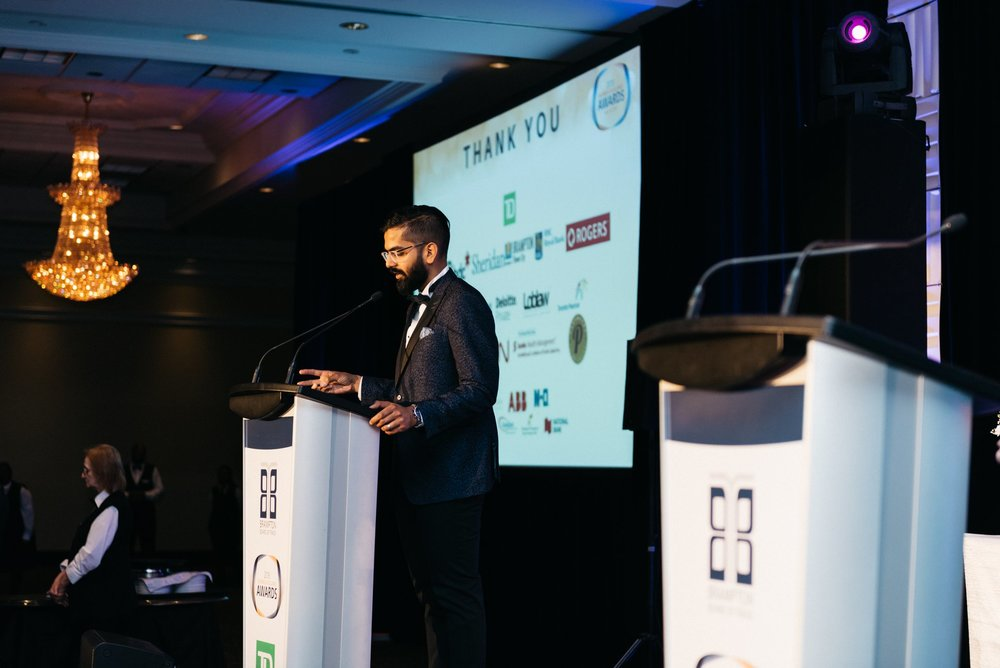 Nav emceeing the Brampton Board of Trade's Business Excellence Awards in 2018