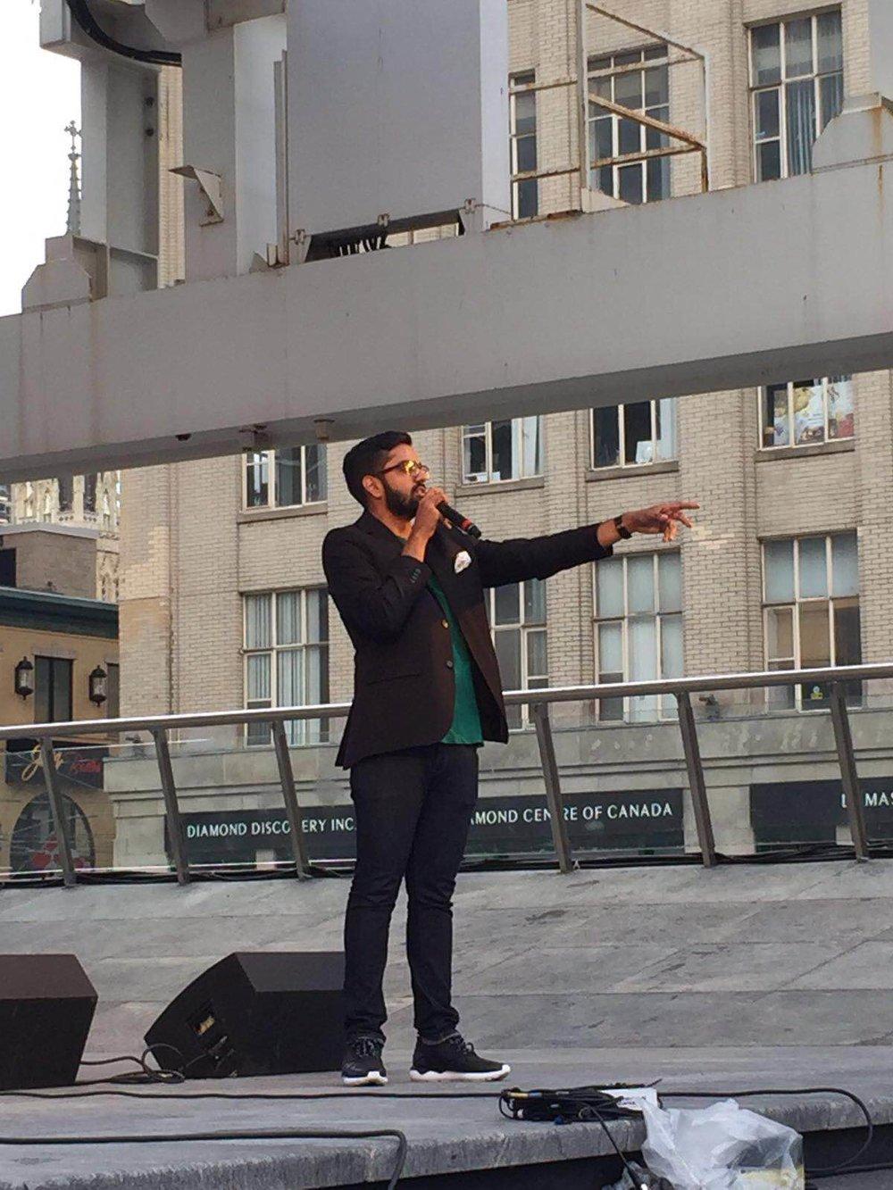 Nav emceeing DiversityFest 2016 at Yonge and Dundas Square in Toronto.