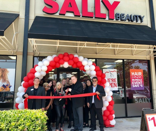Sally Ribbon Cutting.jpg