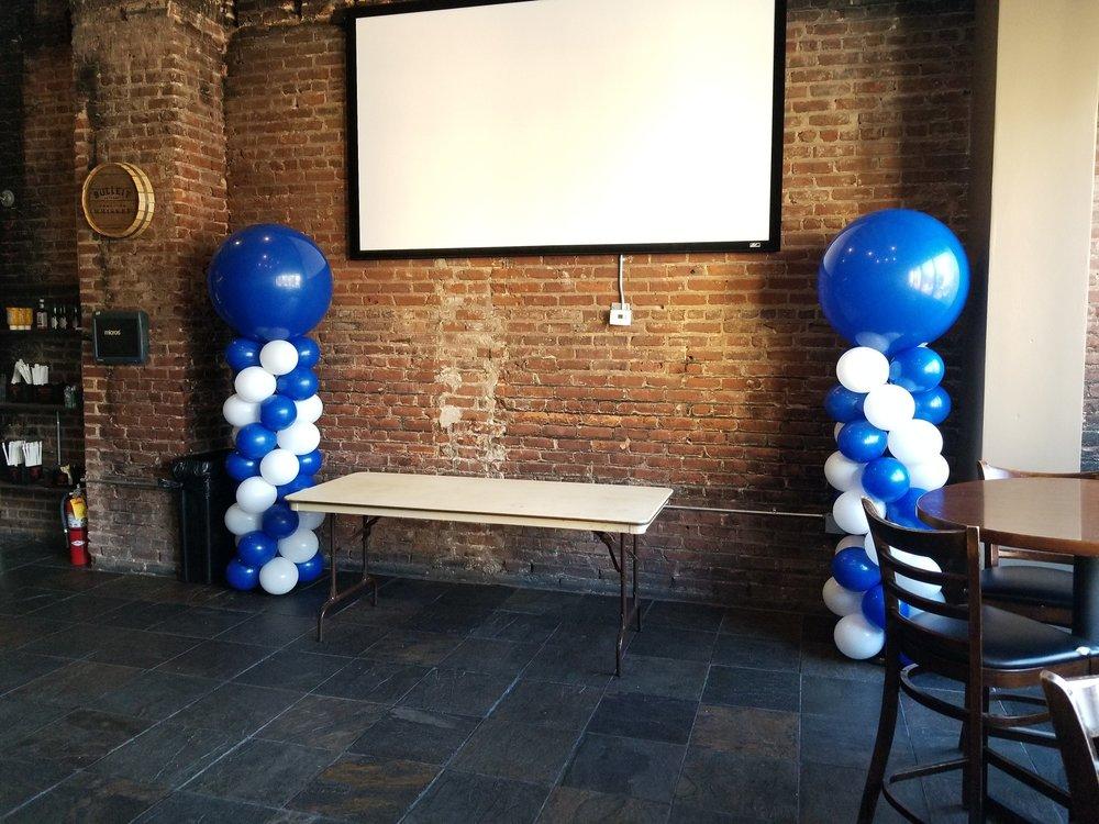 Blue balloon columns.jpeg