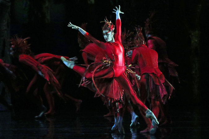 "Misty Copeland and fellow members of American Ballet Theater in ""Firebird"" in May. Credit Andrea Mohin/The New York Times"