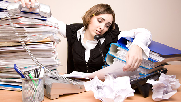 woman-busy-at-cluttered-desk.jpg