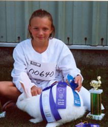 MCKENNA MERTENS, 9, WI, WITH HER WHITE FLEMISH GIANT
