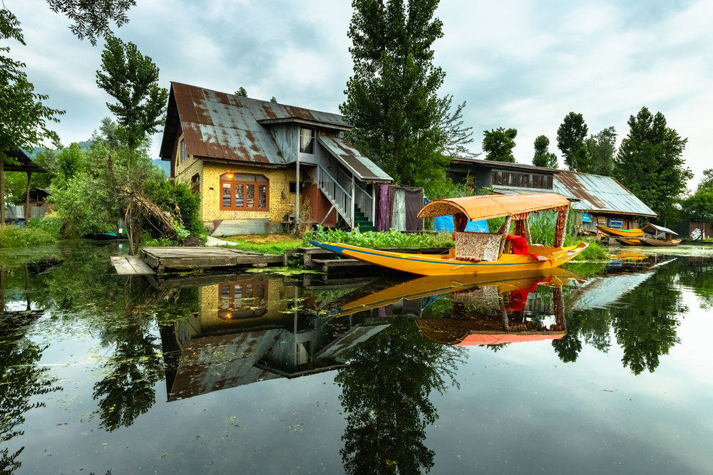 Beautiful Reflections of Local Home and boat on return from Vegetable Market