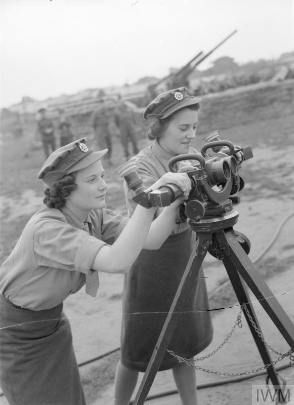 Gunner Girls learning how to use an identification telescope on September 24, 1941. (Courtesy of the Imperial War Museum)