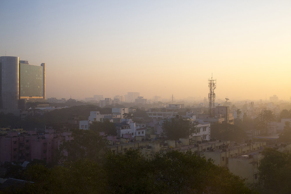 First night's view from hotel looking across the late afternoon hazy skyline of Chennai in blistering heat.