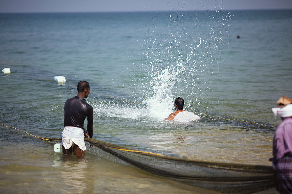 Slapping the water is to drive the fish into the back of the net as they are dragged onto the beach, it stops the fish escaping out of the sides and front of the nets. This was done very energetically and soulfully with chanting, singing and laughing.