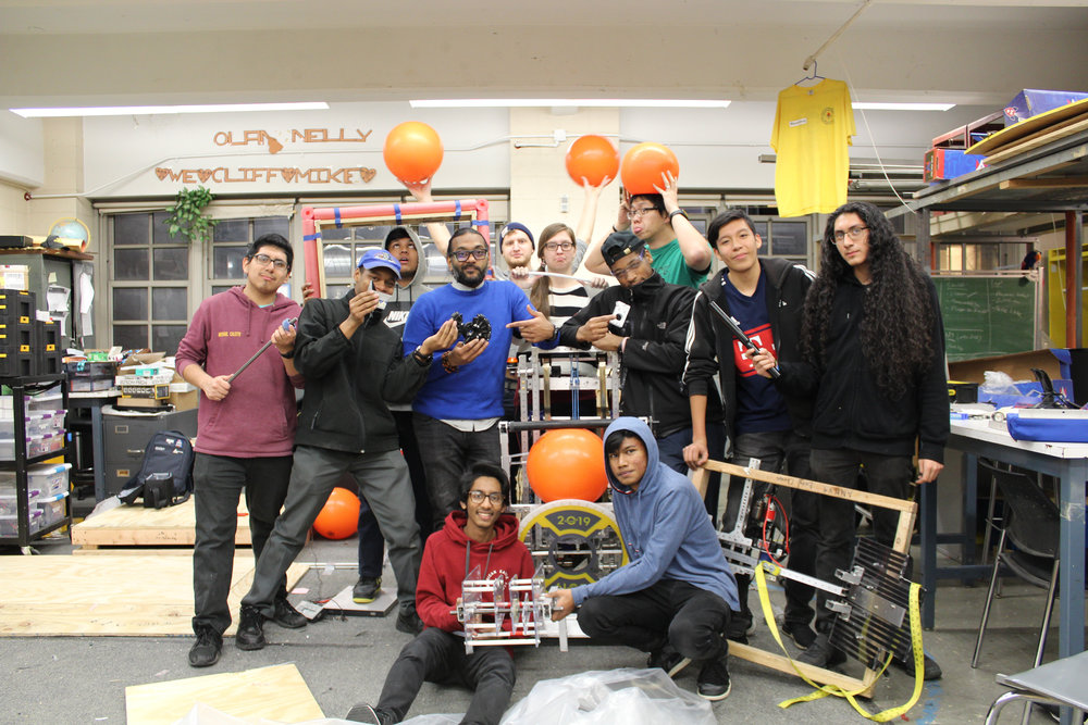 The G-House Pirates celebrating the last Bag n' Tag day at the end of the 2019 build season with all of our failed prototypes and broken pieces.